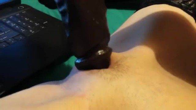 Watching interracial porn and cumming on her bbc fake penis